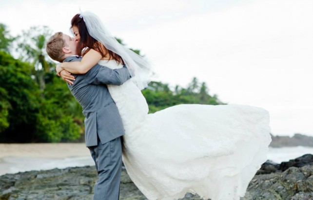 A happy couple celebrate at Stonehaven Bay, Tobago after their wedding