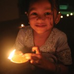 A little girl holds a deya at Divali. Photographer: Shirley Bahadur