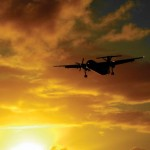 A Caribbean Airlines Dash-8 Tobago Express plane descends in to Crown Point Airport. Photographer: Giancarlo Lalsingh