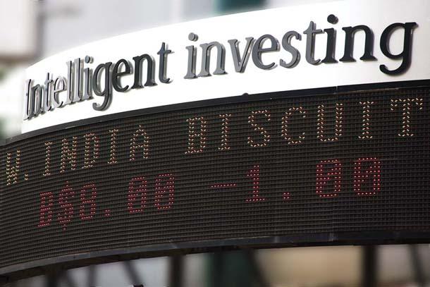 The T&T Stock Exchange ticker. Photographer: CafeMoka