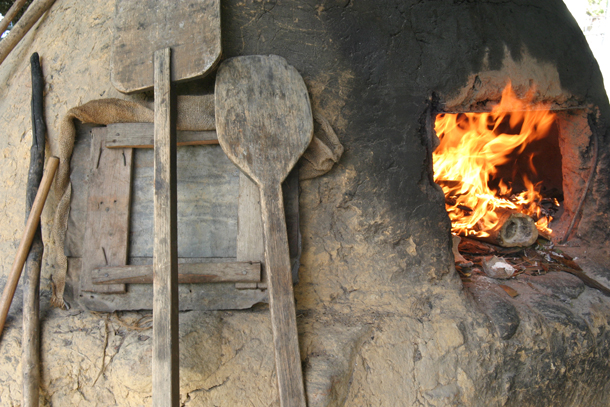 Flames in a traditional clay oven at Castara, Tobago. Photographer: Skene Howie