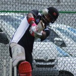 Dwayne Bravo warms up