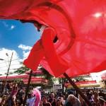 A moko jumbie dances overhead in Trinidad Carnival. Photo: Maria Nunes