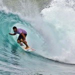 Surfing a wave in Tobago. Photo: Martin Superville courtesy the Surfing Association of Trinidad & Tobago