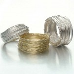 Silver and gold coiled fine wire rings by Janice Derrick of Trinidad