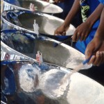 A tenor line of steel pans front a steelband at Panorama. Photographer: Sean Drakes/Blue Mango