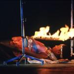 A dancer performs the flaming limbo. Photographer: Sean Drakes/Blue Mango