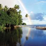 A rainbow stretches over Nariva, where the river meets the sea. Photographer: Andrea de Silva