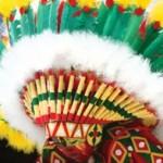 A young masquerader plays Wild Indian Mas. Photographer: Edison Boodoosingh