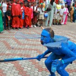 A blue devil intimidates the crowd at the Scarborough Esplanade. Photographer: Onika Henry