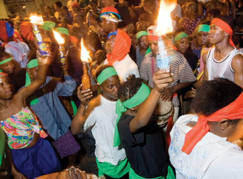 Performers in the Canboulay Riots re-enactment on Carnival Friday morning. Photographer: Mark Lyndersay