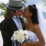 A happy couple celebrate their nuptials in Tobago. Photographer: Roberta Parkin