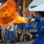 A blue devil breathes fire. Photographer: Onika Henry