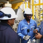 BHP Billiton oil rig workers. Photographer: Courtesy T&T Business Guide