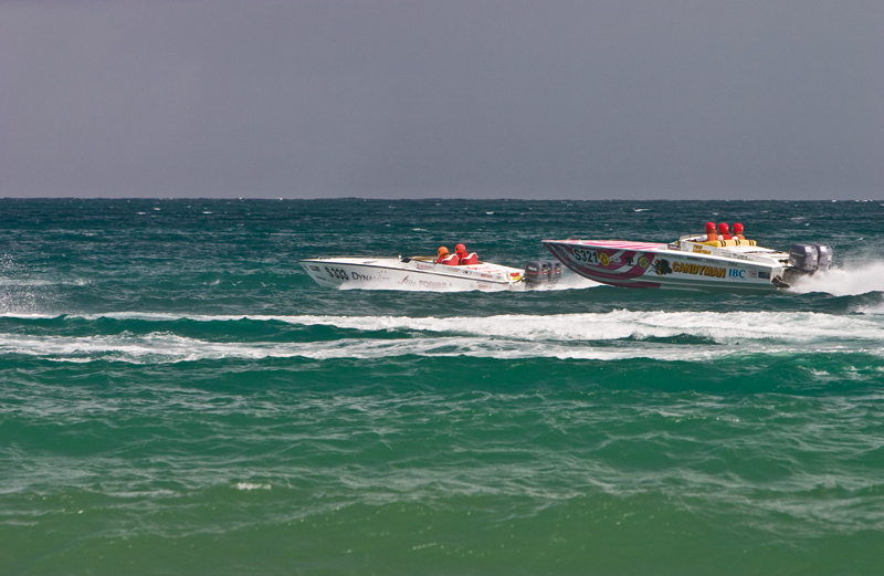 Speedboats pass Scarborough in the Carib Great Race. Photographer: Martin Kellner
