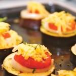 Sliced baigan (melongene) topped with fresh tomato, onion, cheese and local herbs. Photographer: Marc Seyon/Very Caribbean Ltd (verycaribbean.com)