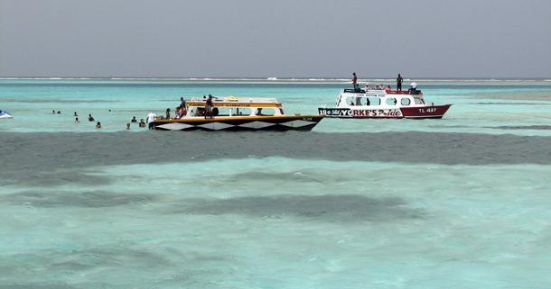 Glass-bottom boats at the Nylon Pool. Photographer: Caroline Neisha Taylor