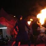 Blue devils breathing fire early on Jouvay morning. Photographer: Shirley Bahadur