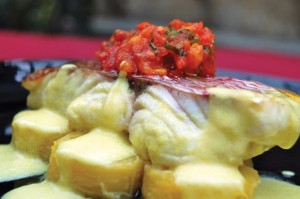 Steamed red snapper over plantain with tomato choka, by Chef Sabrina Rosales. Photographer: Desiree McEachrane