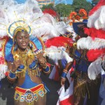 """A player of contemporary """"bikini beads and feathers"""" mas in Tobago Carnival. Photo courtesy the THA."""