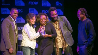 Abigail Hadeed (white jacket), producer of Play the Devil, and lead actors Penelope Spencer, Nickolai Salcedo and Che Rodriquez, celebrate their Award for Best Film as determined by a Youth Jury, with Joel Nanton of COSTAATT (L). Photo courtesy TTFF