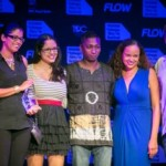 from L - R: Cindy-Ann Gatt, Marketing Director, Flow presents the People's Choice Award for Best Feature Film to the cast and crew of The Cutlass - Darisha Beresford, the director, Teneille Newallo, the screen writer and producer, lead actor Arnold Goindhan and crew members Julietter McCawley and Drew Umland. Photo courtesy ttff