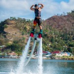 Dolphin-boarding is a new watersport gaining popularity in Cocorite. Photo by Caristock