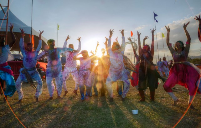 Phagwa revellers dance at sunset. Photo by Chris Anderson