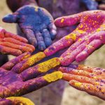 Hands covered with colourful abir powder at Phagwa (Holi). Photo by Nyla Singh