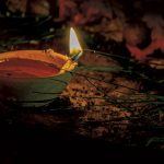 A deya lit for Divali. Photo by Rapso Imaging