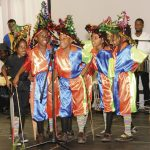 The Speechettes of Scarborough RC school in a traditional speech band performance, where costumed characters speechify in rhyme. It is popular at Carnival and during Heritage Festival. Photo courtesy the THA
