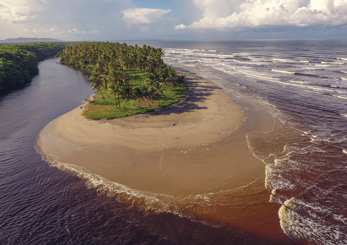 The Nariva river meets the sea near Manzanilla. Photo courtesy the TDC