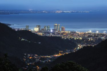 The view from Paramin of Port of Spain with the lights of Point Lisas visible across the Gulf of Paria. Photo by Chris Anderson