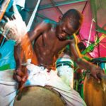 A young member of the Laventille rhythm section plays during the Laventille steelband Festival. Photo by Maria Nunes