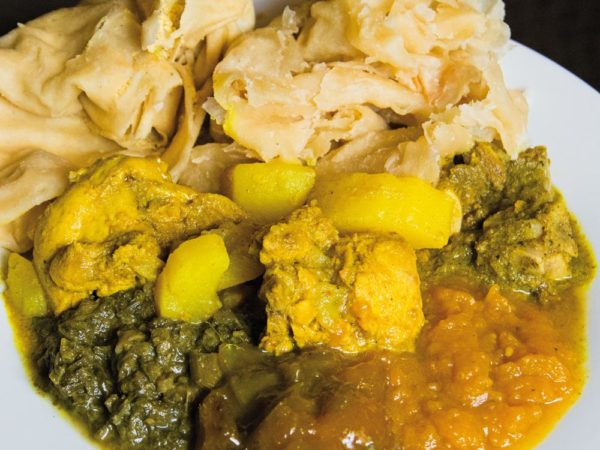 """Curry with """"buss-up-shut"""" are a Trini staple. Photo courtesy Foodie Nation TT"""
