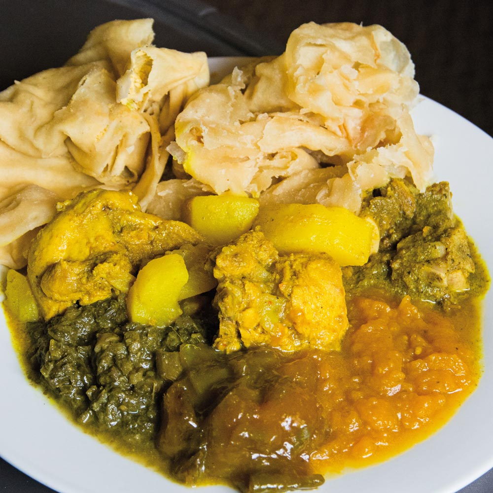 "Curry with ""buss-up-shut"" are a Trini staple. Photo courtesy Foodie Nation TT"