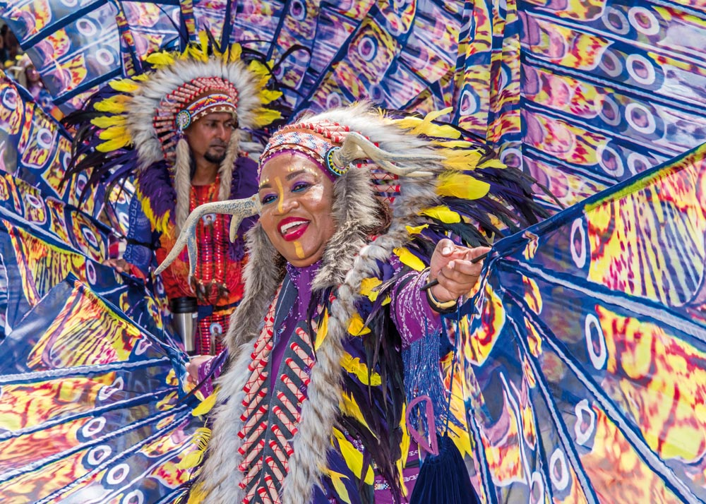Masqueraders from K2K Alliance & Partners, Medium Band of the Year cross the Savannah stage on Carnival Tuesday. Photo by Rapso Imaging