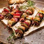 Skewers of grilled vegetables and meat. Photo by ZI3000/Shutterstock.com