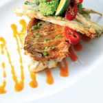 Pan-fried snapper with tempura vegetables and herb topping. Photo by Erwinova/Shutterstock.com