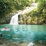A swimmer enjoys the pristine waters of Argyle Waterfall