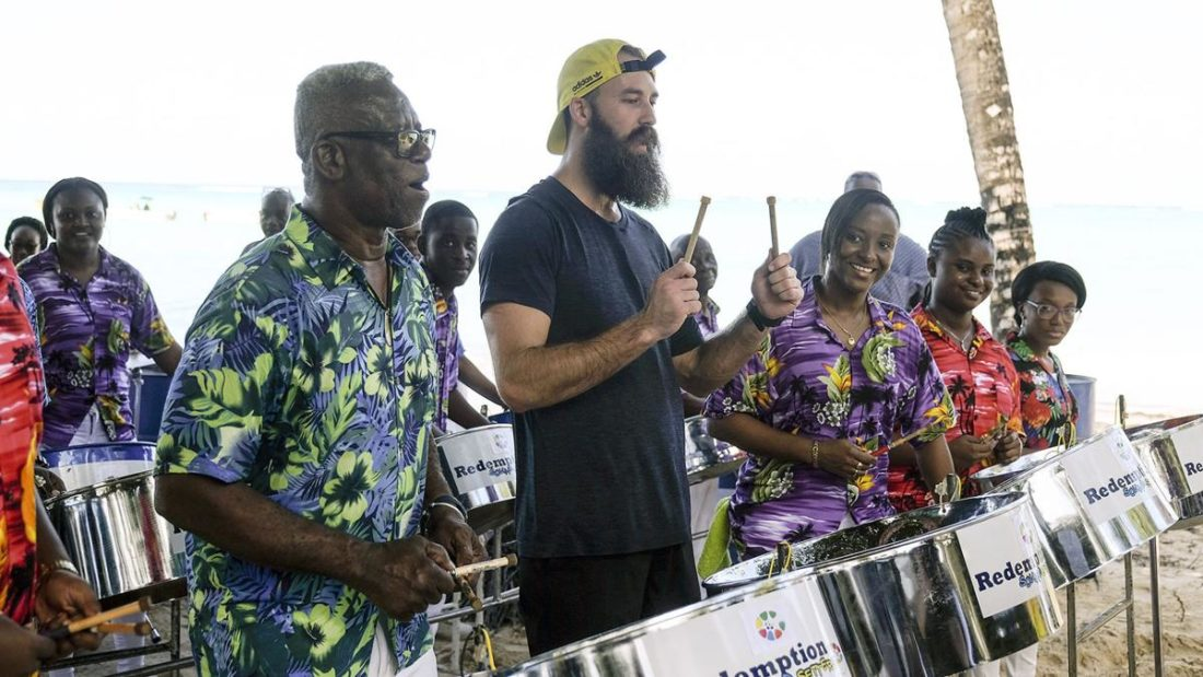 Professional volleyball player Maddison McKibbin plays some pan with Redemption Sound Setters in Tobago